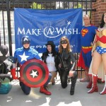 The heroes with the Make-A-Wish sign.